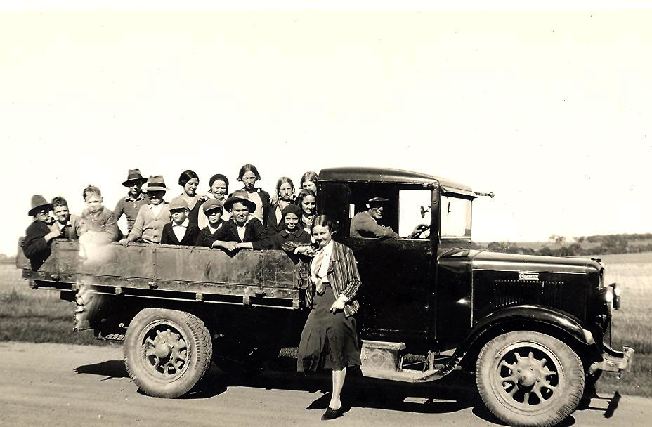 A truck loaded with passengers
