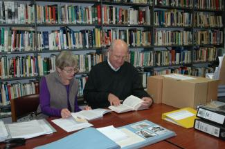 Two researchers working in the Society's Library